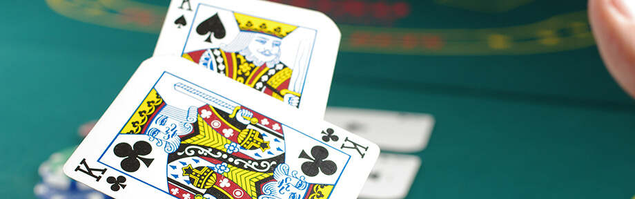 Image of royal king cards over a table - feel like royalty with VIP perks