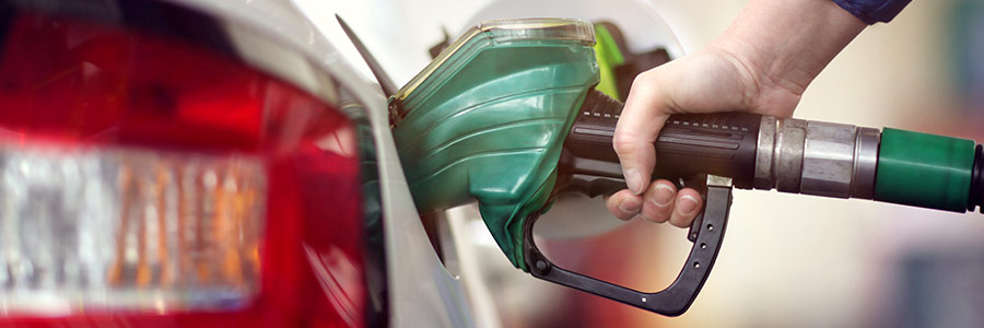 green gas pump with person fuelling up car